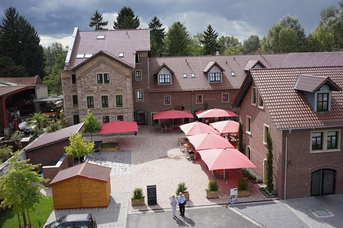 Sutter's Landhaus drones view daytime umbrellas